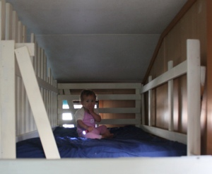 Emmaly using the bunk bed